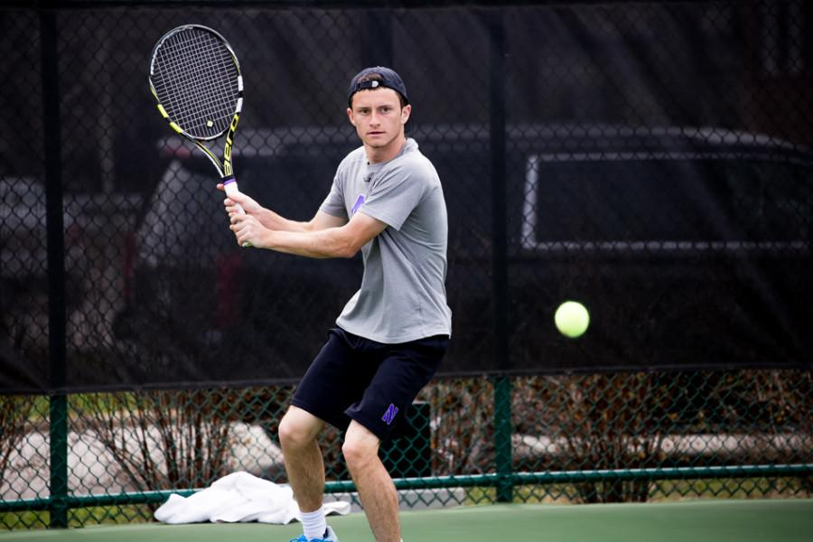 Logan+Staggs+readies+his+return.+The+freshman+lost+the+deciding+match+in+Northwestern%E2%80%99s+4-3+defeat+against+Minnesota.