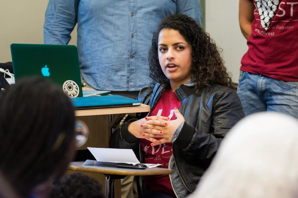"""Melisa Stephen (Weinberg '14) speaks about """"pinkwashing"""" in the Israeli-Palestinian conflict. At Northwestern Divest's event Thursday, Stephen said Israel tries to promote its inclusive LGBT policies to hide its record of human rights abuses."""