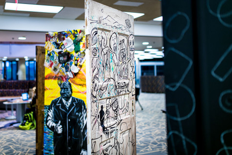 """The """"Opening Doors"""" art installation opened in the South Tower of University Library on Friday. The installation features murals on four recycled doors designed by students and artists."""