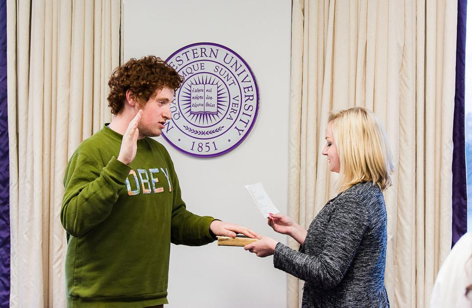 Noah Star is sworn as the new Associated Student Government president by outgoing President Julia Watson at Senate on Wednesday. Star's running mate, Christina Kim, was also sworn in as ASG's executive vice president.