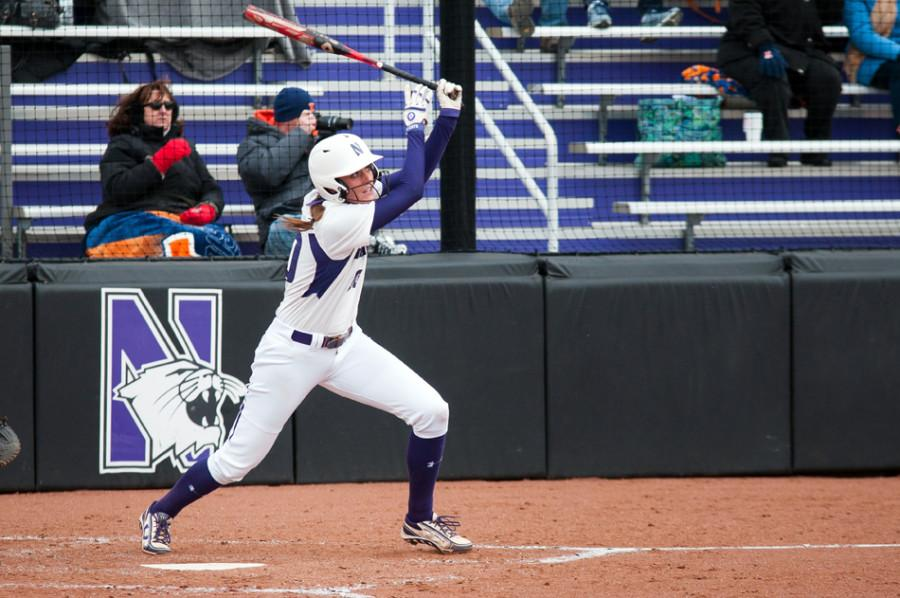Andrea Filler watches a home run fly away. The junior infielder drove in 4 runs in Northwestern's doubleheader against Illinois.
