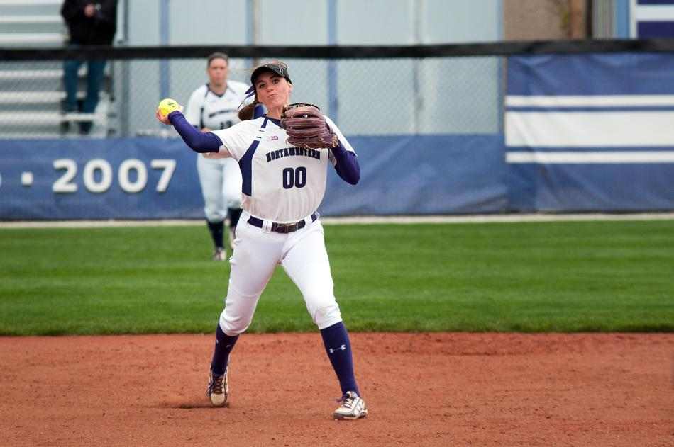 Junior infielder Andrea Filler steps into a throw after fielding the ball. The Wildcats prepare for the final series of the regular season on the road this weekend against Iowa.
