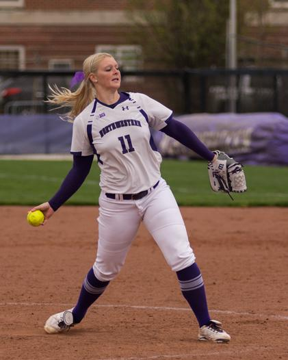 Junior pitcher Kristen Wood winds up for a pitch. Northwestern's staff struggled last weekend against Minnesota, surrendering 31 runs in three games.