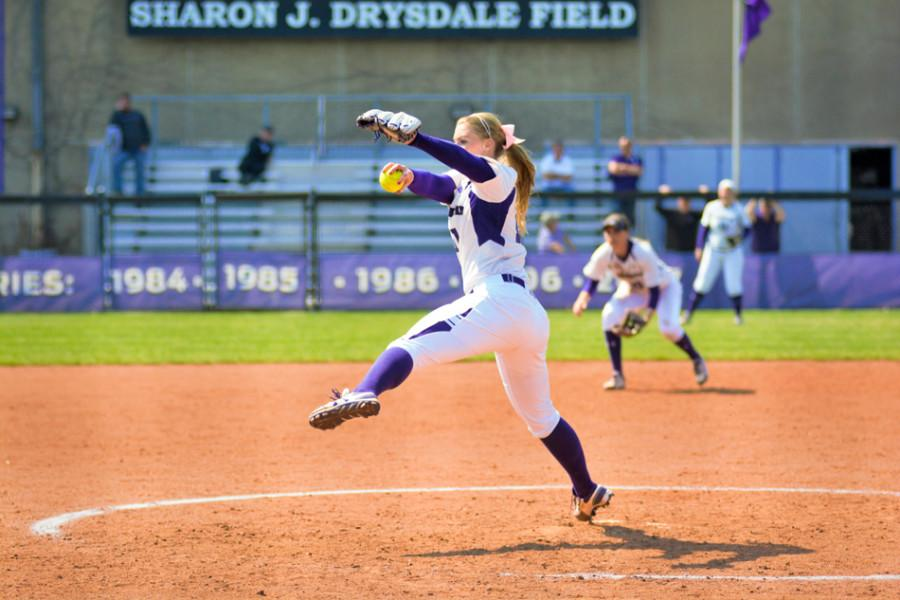 Kristen Wood winds up for a pitch. The junior had a record game Sunday, tossing a career-high 14 strikeouts.