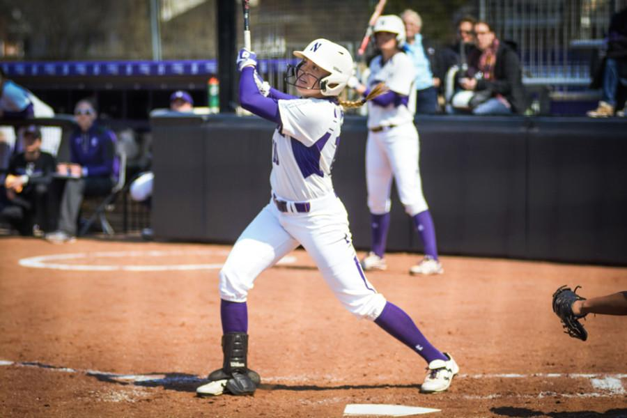 Andrea+DiPrima+watches+the+flight+of+a+hit.+The+senior+outfielder+has+launched+a+team-high-tying+eight+home+runs+this+season.+