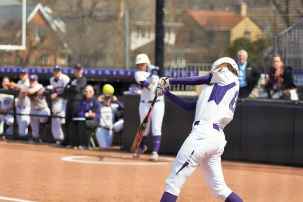 Andrea Filler takes a big swing. The junior shortstop took home Big Ten Player of the Week honors for her strong performances against Illinois and Ohio State.