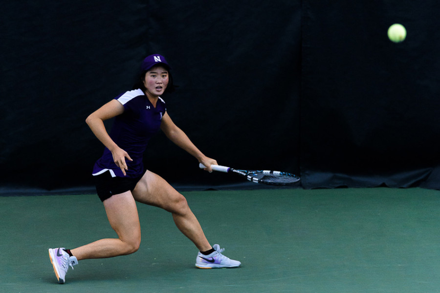 Lok Sze Leung returns a shot. The senior won both her singles matches and both her doubles matches over the weekend as Northwestern went undefeated.