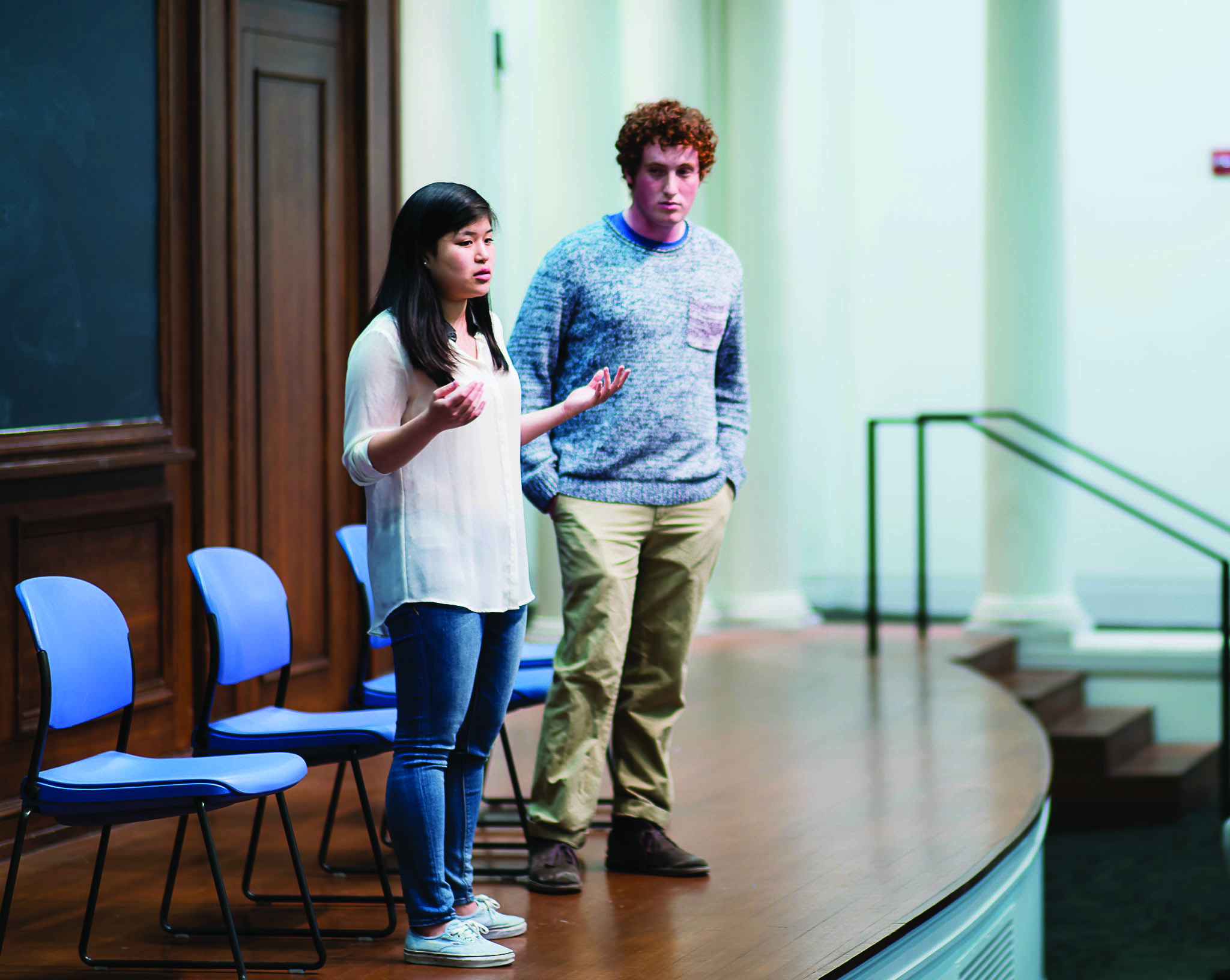 Weinberg junior Noah Star (right) and McCormick junior Christina Kim introduce themselves at a Coalition of Colors-sponsored debate Monday night. The two are running for Associated Student Government president and executive vice president.