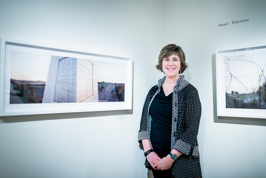 """Photographer Terri Warpinski with her """"Surface Tension"""" exhibit at the Dittmar Gallery. The exhibit will run in Illinois until May 8."""