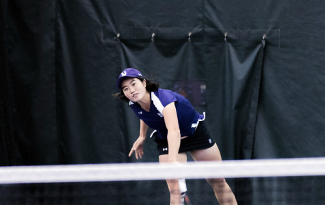 Lok Sze Leung delivers a serve. The only senior on the roster has been a steadying influence for the underclassman-laden team.