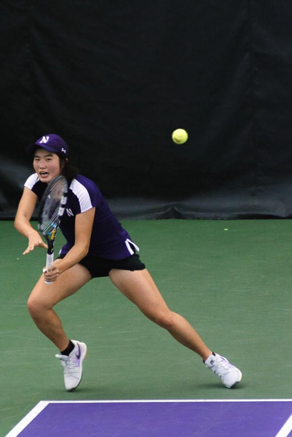 Senior Lok Sze Leung returns a shot. Leung and the Cats finish the regular season this weekend, which includes a Senior Day matchup against Nebraska.