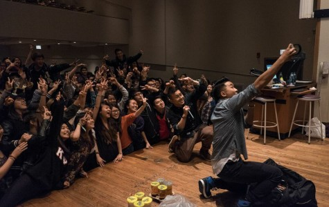 David and Andrew Fung crouch down to take a selfie with Northwestern students. The Fung Bros, a comedic YouTube duo, arrived at Northwestern Friday for a night of jokes and Asian culture.