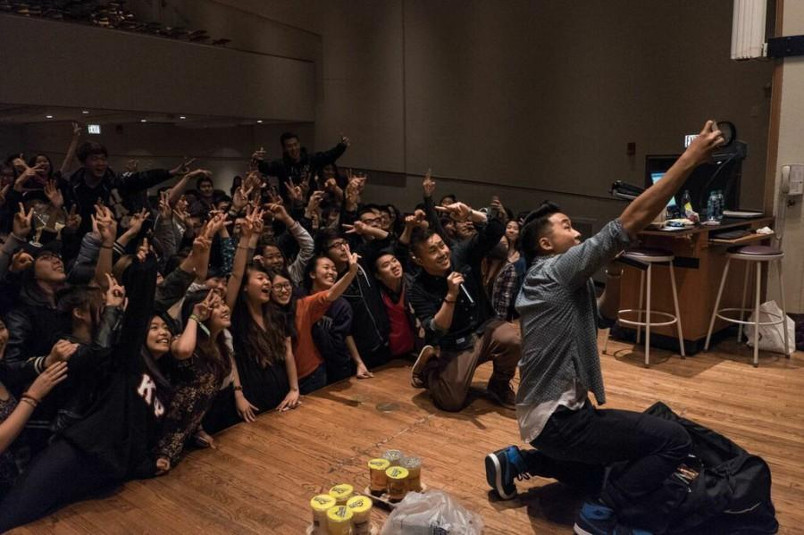 David+and+Andrew+Fung+crouch+down+to+take+a+selfie+with+Northwestern+students.+The+Fung+Bros%2C+a+comedic+YouTube+duo%2C+arrived+at+Northwestern+Friday+for+a+night+of+jokes+and+Asian+culture.