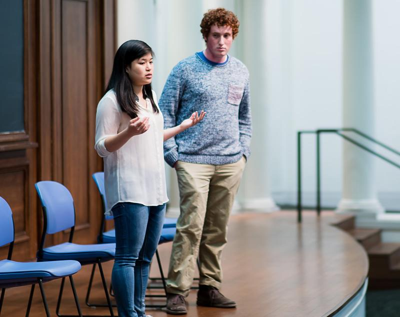 """ASG President Noah Star and Executive Vice President Christina Kim speak at a debate April 6. The two released their first """"100-Day Plan"""" on Sunday."""