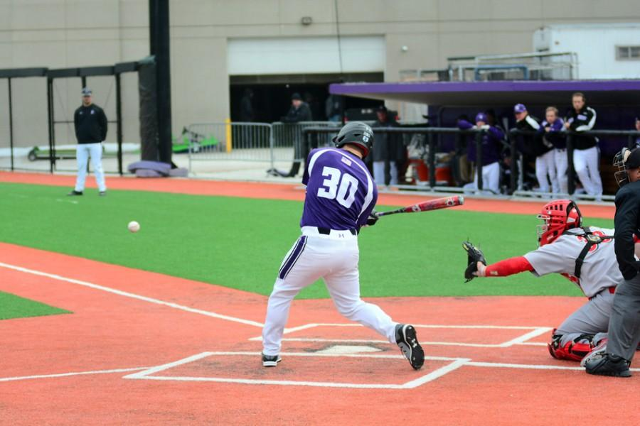 Joe Hoscheit swings at an incoming pitch. The sophomore made an appearance on the mound late in the game Wednesday but failed to close out the contest for Northwestern.