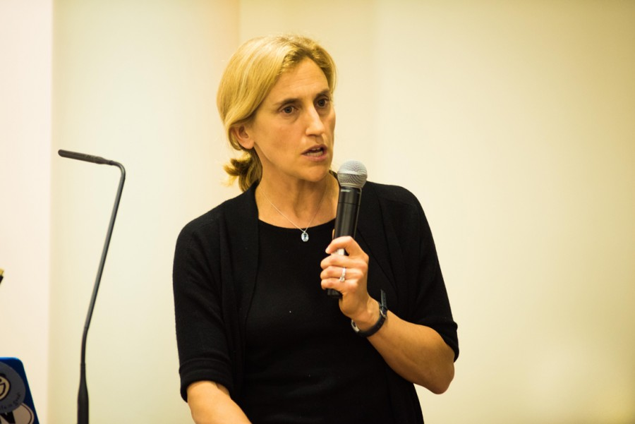 Mikki Hebl, a psychology professor at Rice University, speaks to students in Harris Hall. Hebl discussed how unconscious bias can influence treatment of minority groups.