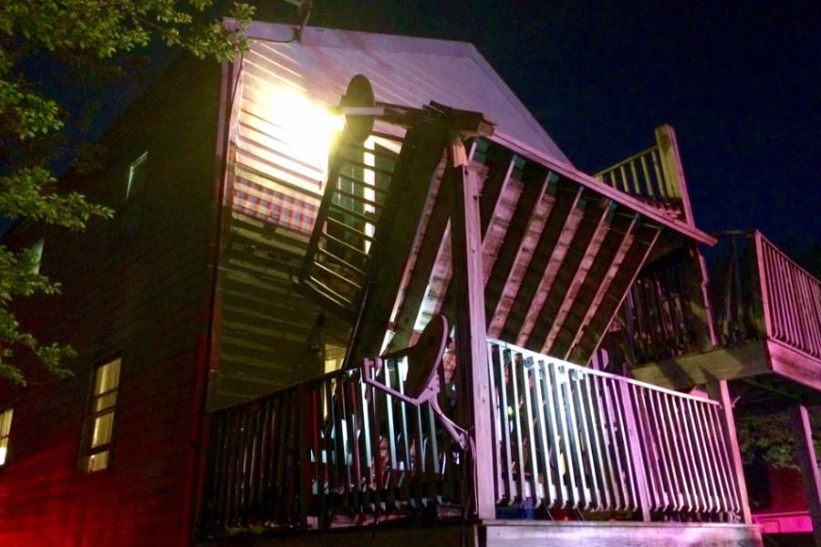 The second-floor porch of an Evanston building collapsed Monday night. Around a dozen people were present, and four were taken to the hospital with minor injuries.