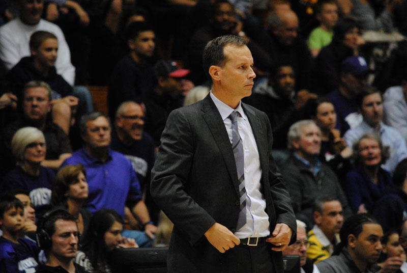 Chris Collins surveys the court from the sideline. The coach has taken a deliberate approach to rebuilding Northwestern's historically unsuccessful program.