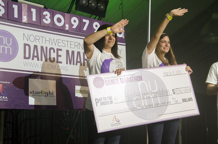 Representatives+from+the+Starlight+Children%E2%80%99s+Foundation+receive+a+check+at+this+year%E2%80%99s+Dance+Marathon.+The+event+raised+enough+money+to+create+11+Starlight+Sites+for+its+beneficiary.+