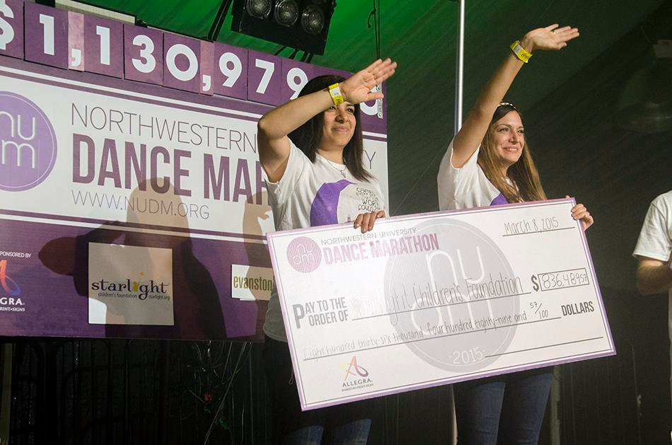 Representatives from the Starlight Children's Foundation receive a check at this year's Dance Marathon. The event raised enough money to create 11 Starlight Sites for its beneficiary.