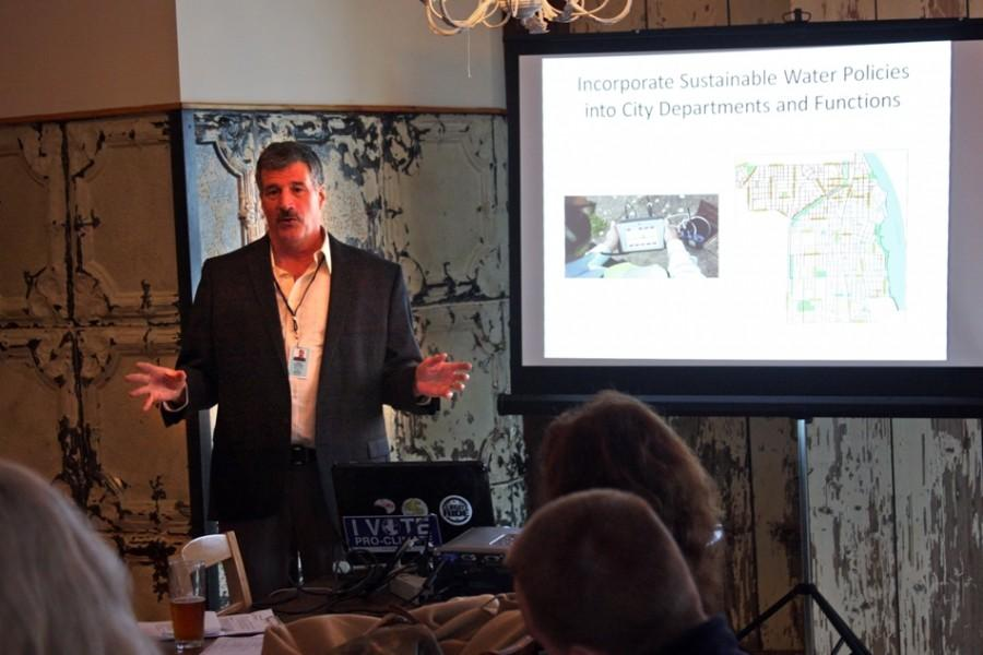 Dave Stoneback, Evanstons director of utilities, addresses the audience at the Green Drinks talk held at Farmhouse Evanston. Stoneback updated the audience on the citys water conservation plan.