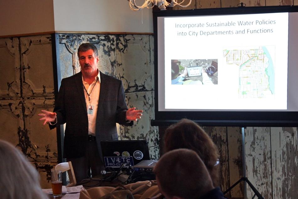 Dave Stoneback, Evanston's director of utilities, addresses the audience at the Green Drinks talk held at Farmhouse Evanston. Stoneback updated the audience on the city's water conservation plan.