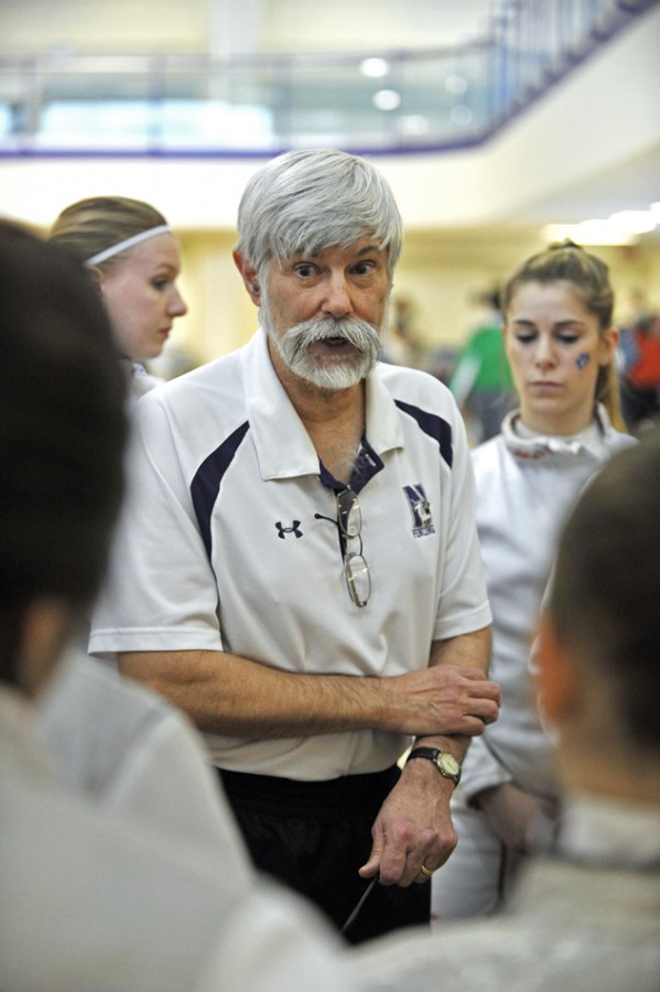 Laurie+Schiller+provides+instruction+to+one+of+his+fencers.+The+coach+was+named+the+Midwest+Fencing+Conference+Coach+of+the+Year+for+the+10th+time+in+his+career.