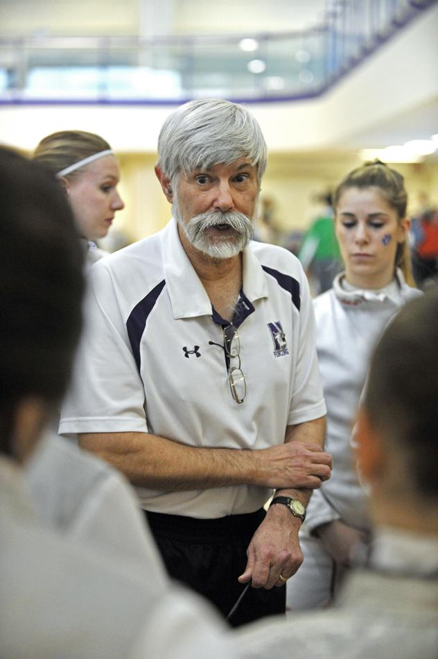 Laurie Schiller provides instruction to one of his fencers. The coach was named the Midwest Fencing Conference Coach of the Year for the 10th time in his career.