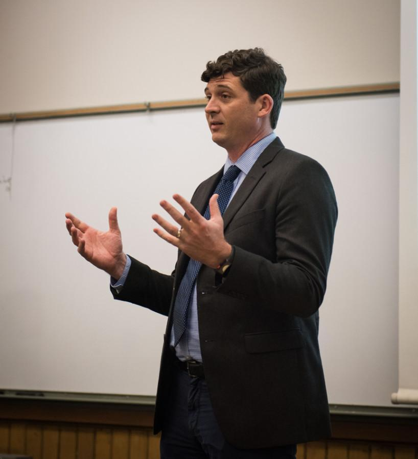 Michael Brenner, a member of presidential hopeful Hillary Clinton's Illinois team, speaks to College Democrats about grassroots involvement Tuesday evening. Brenner emphasized the importance of organizing early for a campaign's success, and encouraged Northwestern students to volunteer for Clinton.