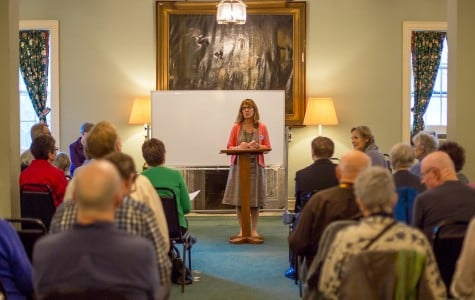 Kathleen Nadler greets a full room Monday night at Evanston's First Congregational Church. Nadler, the president of Interfaith Action of Evanston, joined in discussion with other community members on how to act on the city's homelessness crisis.