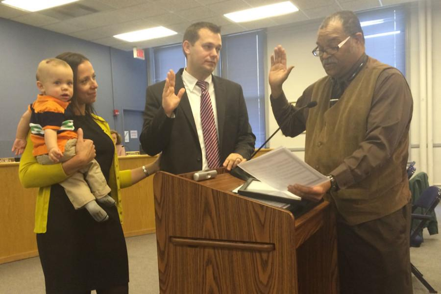 City+clerk+Rodney+Greene+swears+in+Brian+Miller+as+9th+Ward+alderman.+The+new+alderman+took+his+seat+on+City+Council+for+a+Human+Services+Committee+meeting+Monday+immediately+after+he+was+sworn+in.