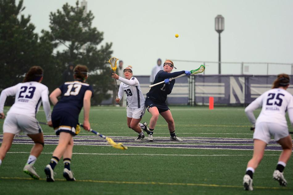 Shelby Fredericks battles for a draw control Sunday against Notre Dame. The freshman leads Northwestern with 66 wins in the circle.