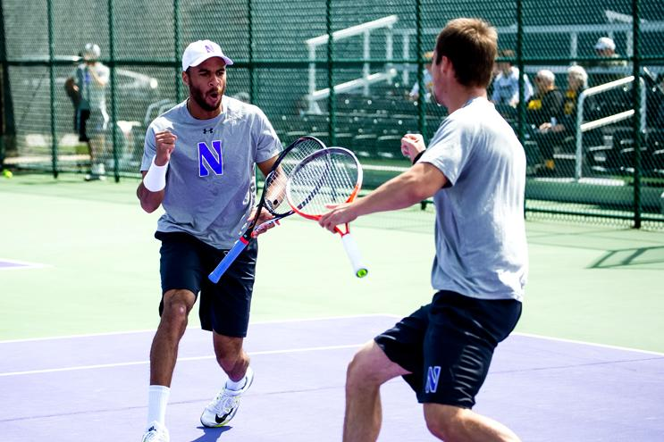 Sophomore Sam Shropshire and senior Alex Pasareanu get fired up. The doubles pair will be vital to Northwestern's success in the NCAA Tournament.