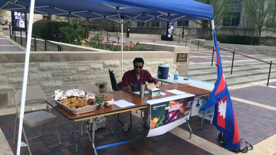 A member of Alpha Iota Omicron sells samosa and mango lassi Thursday outside Technological Institute. AIO partnered with NU Stands with Nepal, a group coordinating with the Northwestern and Evanston communities, to raise funds for the victims of the Nepal earthquake.