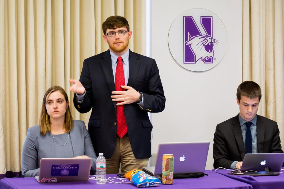 Communication senior Sean Earley, a member of the A-status finances committee, speaks to Senate at its meeting Wednesday. He said the committee spent more than 80 hours drafting the proposal for the roughly $1.1 million A-status funding plan, which Senate approved.