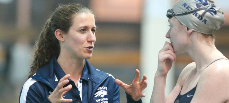 Coach Abby Steketee talks to one of her swimmers at Nevada. The Northwestern alumna was not on the women's swimming and diving team as an undergraduate.