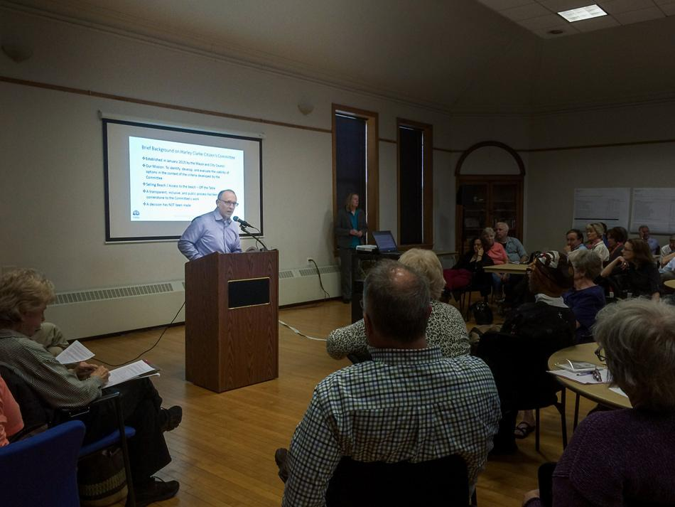 Steve Hagerty, chair of the Harley Clarke Citizens Committee, presents background on the Harley Clarke mansion to a packed room Monday night. The committee has gathered public opinion and research since January to help determine a future for the mansion, and will present its final recommendations to City Council next month.