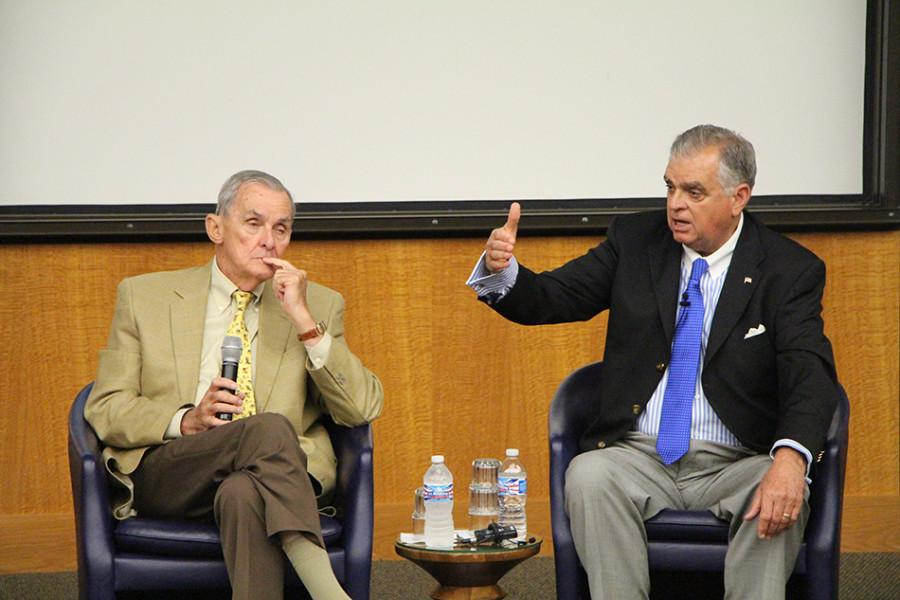 """Former U.S. Transportation Secretary Ray LaHood (right) and former U.S. congressman William Lipinski discuss surface transportation funding at the William O. Lipinski Symposium on Transportation Policy and Strategy on Monday. LaHood and other speakers at the event called for a long-term, sustainably funded transportation bill to fix what he called """"a crisis in transportation."""""""