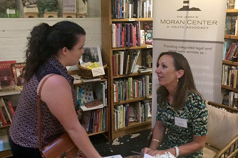 Northwestern alumna Jeanne Bishop signs a copy of her book, Change of Heart, a story about the 1990 Winnetka murder of Bishop's sister and brother-in-law. Bishop spoke about forgiveness and healing at Bookends & Beginnings Tuesday evening and led a discussion about criminal justice.
