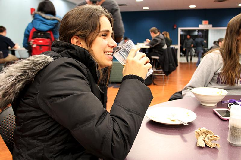 A student eats in a campus dining hall. Beginning this fall, residential assistants will have RA-specific meal plans.