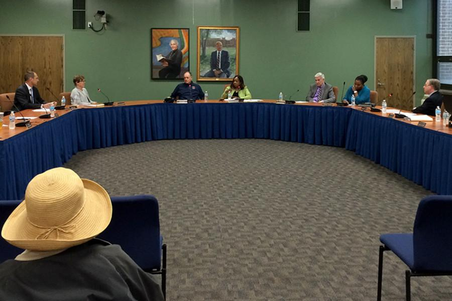 Evanston Township High School board members discuss strategies for appointing someone to fill a vacant board seat at an open meeting Wednesday night. After about 90 minutes of public and private deliberation, the board determined it could not select someone, turning the decision over to the regional superintendent.