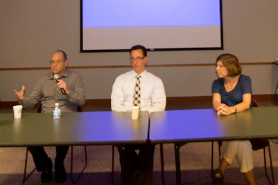 Evanston filmmaker Michael Frolichstein answers questions about Celiac disease alongside pediatric gastroenterologist Vincent Biank and dietitian Carrie Ek. The panel discussion at the Evanston Public Library event followed a screening of Frolichstein's documentary on the illness.
