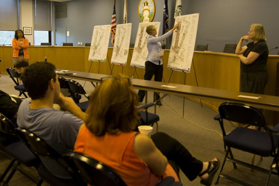 Stephanie Levine from Evanston public works talks a group of community members through the four designs the city is proposing for the Fountain Square Plaza renovation. About 20 residents gathered Tuesday night to provide input on the designs.