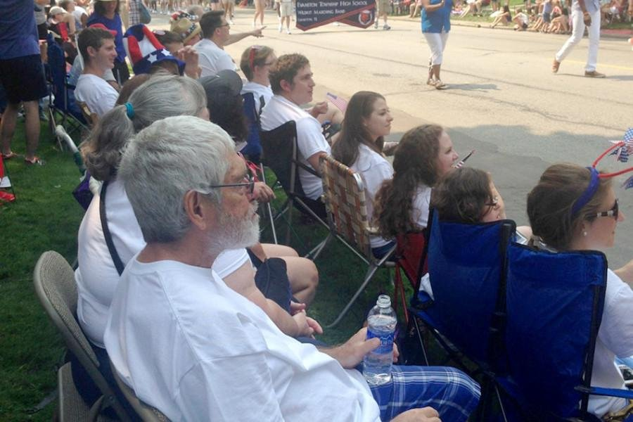 Walter Jackson, son of Alfred Jackson, watches the Evanston Fourth of July parade on Central Street with other members of the family.  Alfred Jackson, who died in 2012 at age 91, was a trustee of the citys Fourth of July Association.
