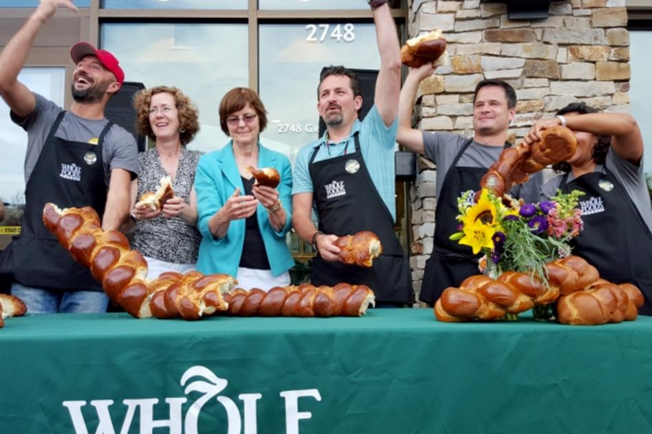 Ald. Jane Grover (7th) and Evanston Mayor Elizabeth Tisdahl attend the grand opening of the city's third Whole Foods store Wednesday.