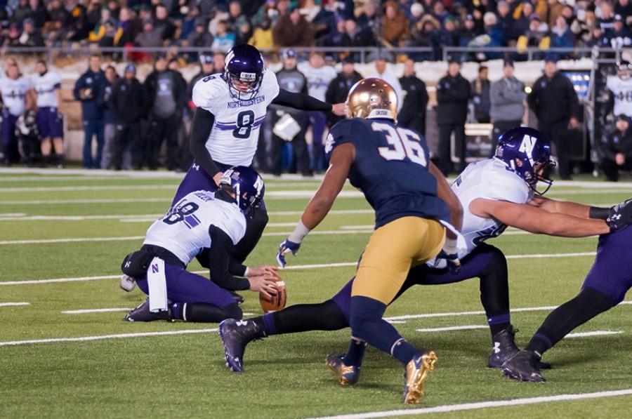 Senior kicker Jack Mitchell kicks a field goal against Notre Dame last fall. Mitchell returns as the Wildcats kicker in 2015.