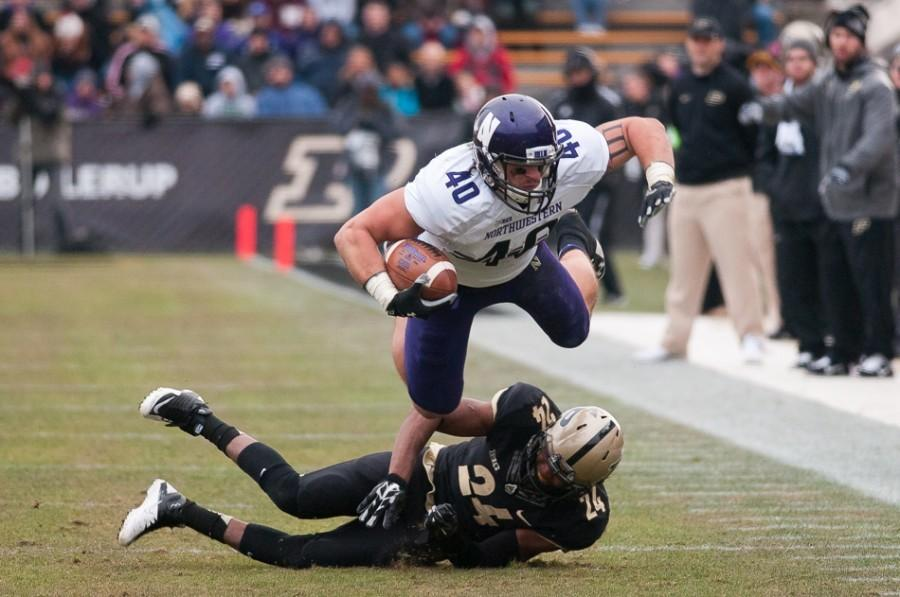 Dan+Vitale+shows+off+his+best+Superman+pose+during++last+season%27s+win+over+Purdue.+Vitale+was+second+on+the+Wildcats+in+catches+and+receiving+yards+in+2014.