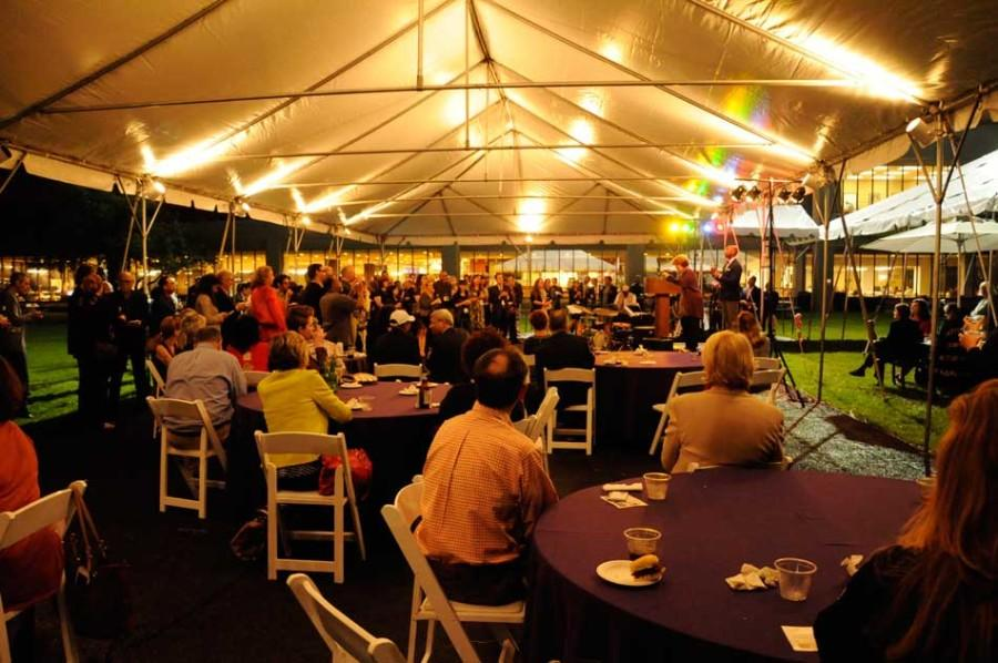 On the first full day of a state arts conference hosted in Evanston, attendees gathered in a tent on the East Lawn of Norris University Center for an opening reception.