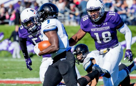 Anthony Walker (18) chases a ball-carrier during Northwestern's win over Eastern Illinois. The sophomore linebacker recorded seven tackles in the game, bringing his season total to a team-leading 17.