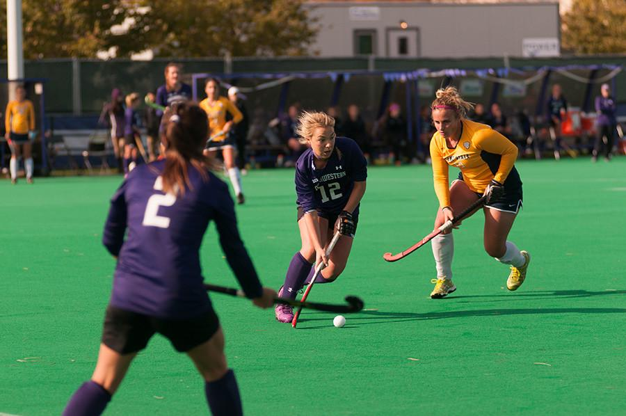 Senior midfielder Charlotte Martin sprints past a defender. The Wildcats will need Martin's experience and leadership as they try to right the ship in Big Ten play.